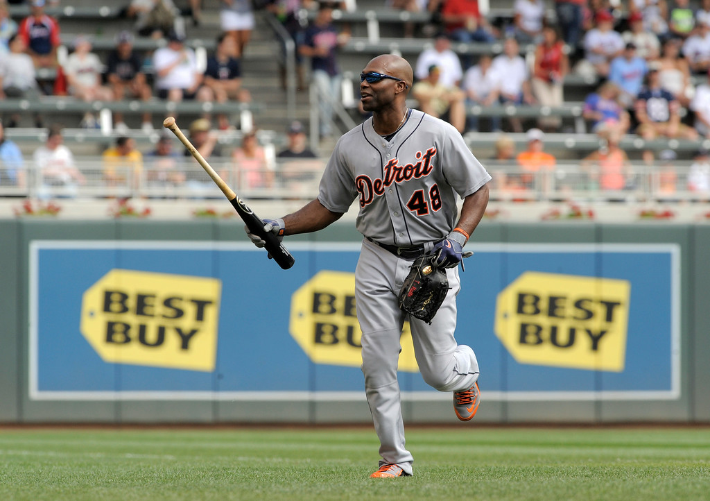 . Detroit Tigers� Torii Hunter runs in for the Tigers\' dugout after warming up prior to a game against the Minnesota Twins in a baseball game in Minneapolis, Sunday, Aug. 24, 2014. (AP Photo/Tom Olmscheid)