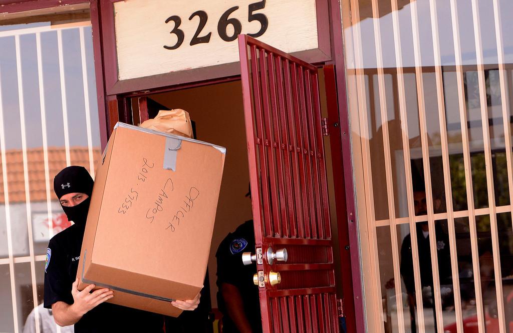 . San Bernardino Police remove evidence from a marijuana dispensary along the 3200 block of North E Street in San Bernardino May 9, 2013.  (Photo by Gabriel Luis Acosta/The Sun)