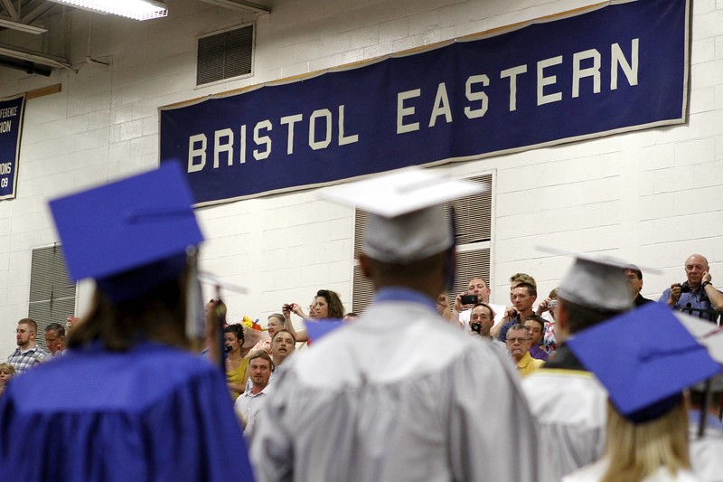 Kevin Bartram | Staff Graduates enter the gym during Bristol Eastern High School graduation on Tuesday at the school. The graduation ceremony was moved indoors due to weather.