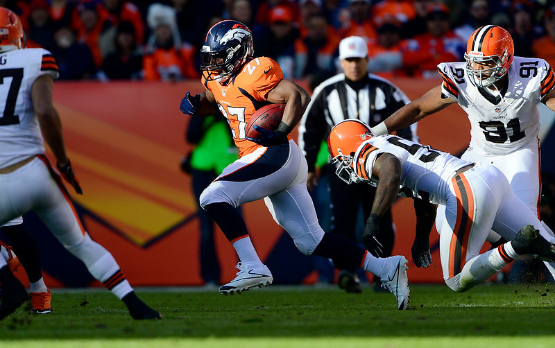 . Denver Broncos running back Knowshon Moreno (27) gains five yards during the first half.  The Denver Broncos vs Cleveland Browns at Sports Authority Field Sunday December 23, 2012. AAron  Ontiveroz, The Denver Post