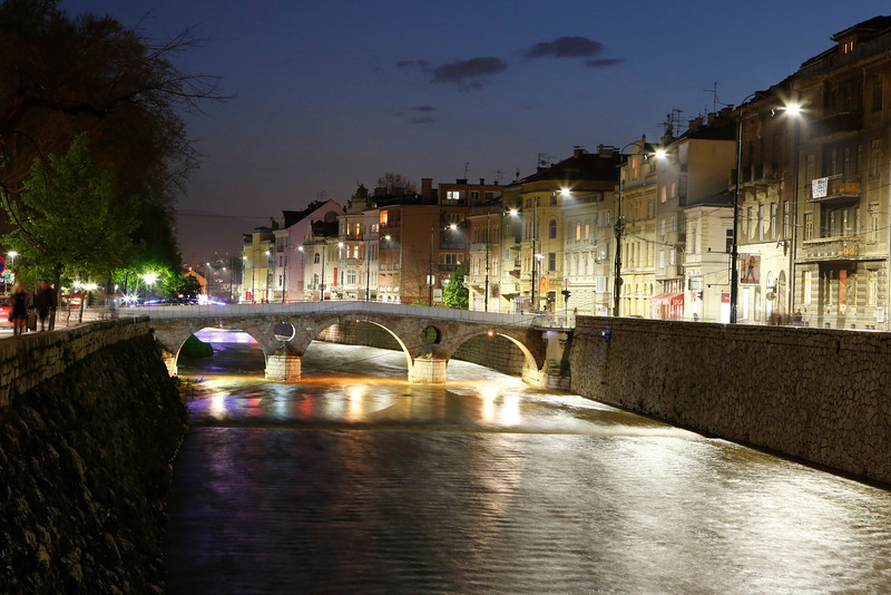 . In this Tuesday, April 22, 2014 photo, Princip Bridge and the surrounding buildings are illuminated at night in Sarajevo, Bosnia-Herzegovina. The city will host a number events around the Centenary of World War I, including a conference of historians and a concert. (AP Photo/Amel Emric)