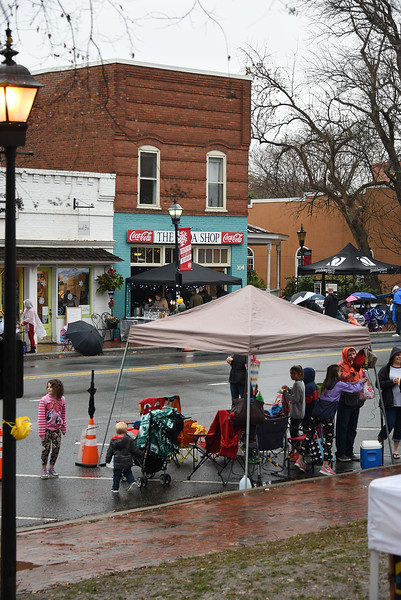 This year's North Mecklenburg Christmas parade was a soggy affair, but many viewers grabbed an umbrella or tent and enjoyed the spectacle nonetheless. (Bill Giduz photo)
