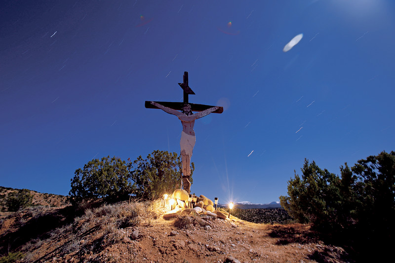 A crucifix overlooks Juan Medina Road during the pilgrimage to the Santuario de Chimayo on Good Friday, April 19, 2019. Luis Sánchez Saturno/The New Mexican