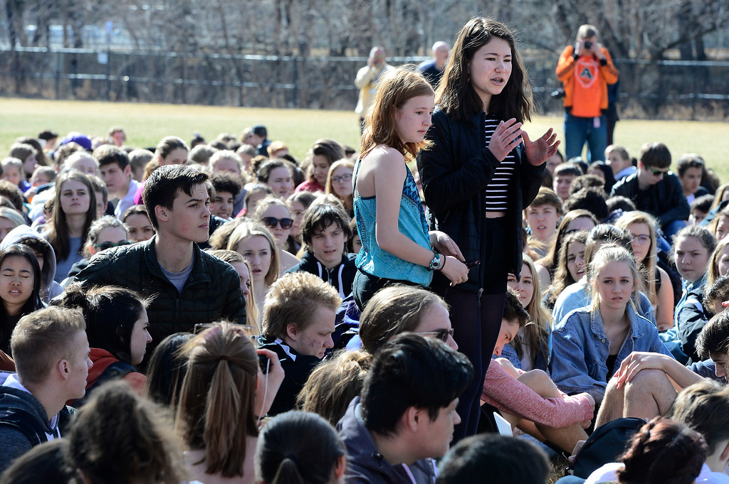 . Finella Guy, left, and Maya Clements speak to the assembled students during a walkout to protest gun violence at Boulder High School on Wednesday morning.  For more photos go to dailycamera.com Paul Aiken Staff Photographer March 14, 2018.