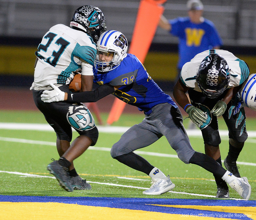 . Wood\'s Alex O\'Neil stuffs Deer Valley running back Patrick Robinson behind the line of scrimmage during the fourth quarter of the Wildcats� 20-8 victory Friday at Wildcat Stadium.
