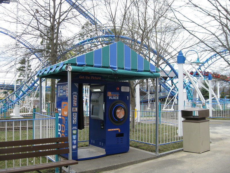 Photo booth under a canopy in front of Canobie Corkscrew.