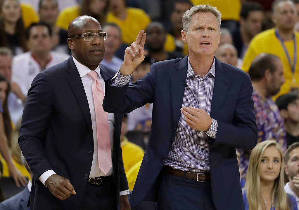 . Golden State Warriors head coach Steve Kerr, right, gestures next to interim head coach Mike Brown during the first half of Game 2 of basketball\'s NBA Finals against the Cleveland Cavaliers in Oakland, Calif., Sunday, June 4, 2017. (AP Photo/Marcio Jose Sanchez)