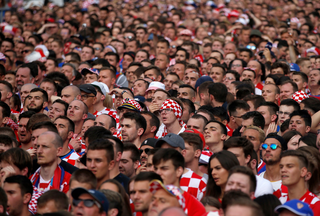 . Croatia soccer fans react during a television broadcast of the Russia 2018 World Cup match between France and Croatia in downtown Zagreb, Croatia, Sunday, July 15, 2018. (AP Photo/Darko Vojinovic)