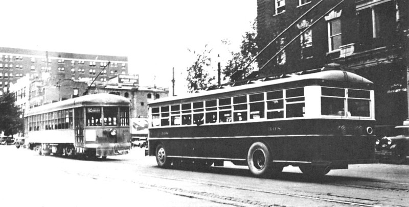 Electric Coach 308, after conversion to single rear axle with dual wheels and tires, follows a Route 12 streetcar. The coach is probably working Route 7, and the scene is looking north on State Street near Temple Square. (Ohio Brass; mca_39-1_14a)