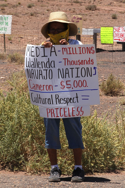 . A unidentified Navajo woman protests along highway, near Cameron, Ariz., on Sunday, June 23, 2013, to protest Florida aerialist Nik Wallenda\'s tightrope walk over the Little Colorado River Gorge. Wallenda plans to perform the stunt without a safety harness on the Navajo reservation. (AP Photo/Rick Bowmer)