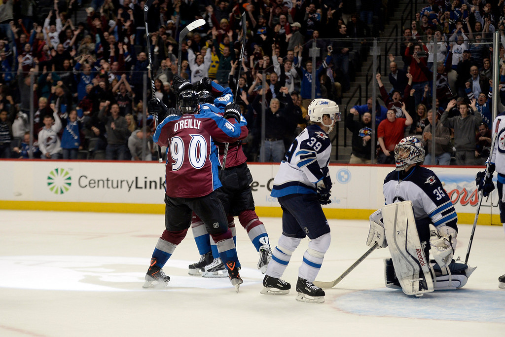 . Matt Duchene (9) of the Colorado Avalanche celebrates his game-winning goal with teammates against the Winnipeg Jets during the Avs\' 3-2 win. (Photo by AAron Ontiveroz/The Denver Post)