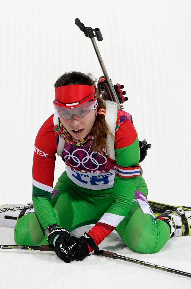 . Belarus\' Nadezhda Skardino catches her breath after winning the bronze during the women\'s 15K individual biathlon race at the 2014 Winter Olympics, Friday, Feb. 14, 2014, in Krasnaya Polyana, Russia. (AP Photo/Matthias Schrader)