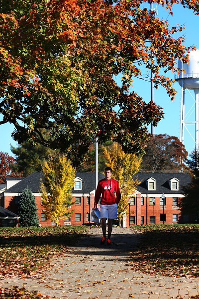 Gardner-Webb University student walking across the campus on a Fall day.