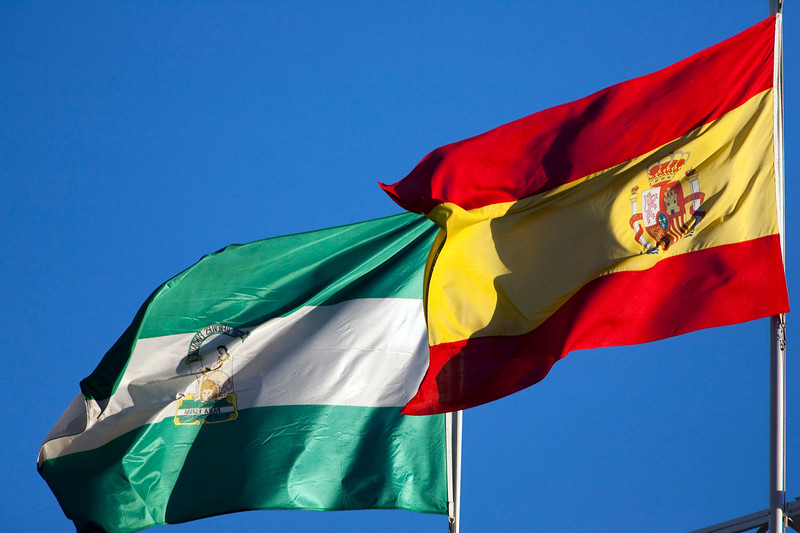 The flags of Spain (right) and the autonomous community of Andalusia, Seville, autonomous community of Andalusia, southern Spain