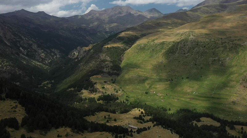 Available in 4k - Aerial video clip showing the Valle de Gistaín near Refugio de Biadós at Sobrarbe, Huesca, on a summer day. Located in the Spanish Pyrenees of Aragon