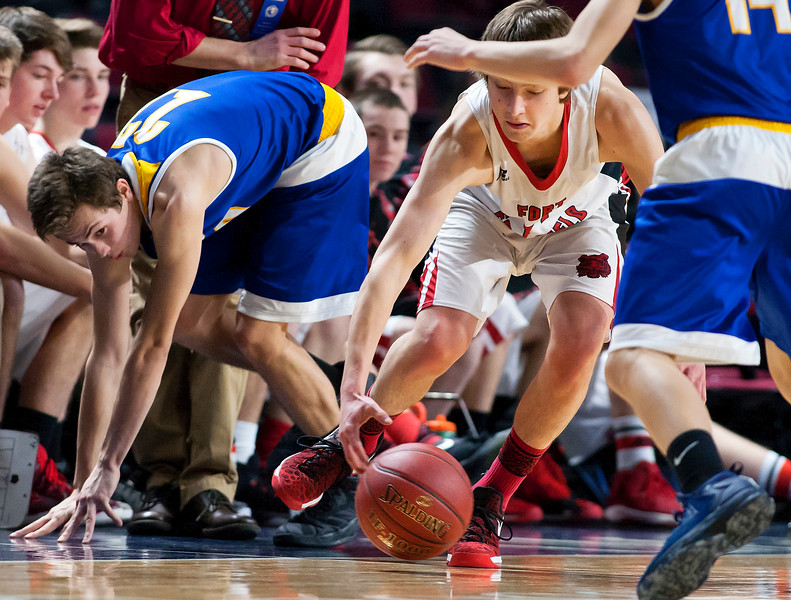 BANGOR, Maine -- 02/21/2017 -- Fort Fairfield's Christopher Giberson (right) battles for a loose ball against Piscataquis' Bryce Gilbert during their Class C boys basketball quarterfinal game at the Cross Insurance Center in Bangor Tuesday. Ashley L. Conti | BDN