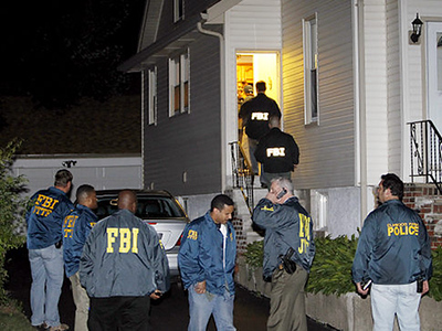 The FBI raids a home at 269 Falmouth Ave in Elmwood Park, NJ  suspected to have ties to terrorism suspect Carlos Eduardo Almonte who was arrested Saturday before he boarded a plane at JFK airport 6/5/10 (William Perlman/The Star-Ledger) Sent DIRECT TO SELECTS Saturday, June 05, 2010 23:23:58 4374 3108   Original Filename: X 06062010terror PERLMAN.JPG   IPTC record 115: The Star Ledger