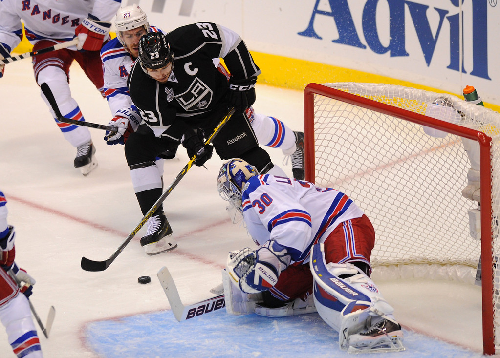 . The Kings\' Dustin Brown shoots against the Rangers goalie Henrik Lundqvist in the second period of game two of the Stanley Cup Final, Saturday, June 7, 2014, at Staples Center. (Photo by Michael Owen Baker/Los Angeles Daily News)