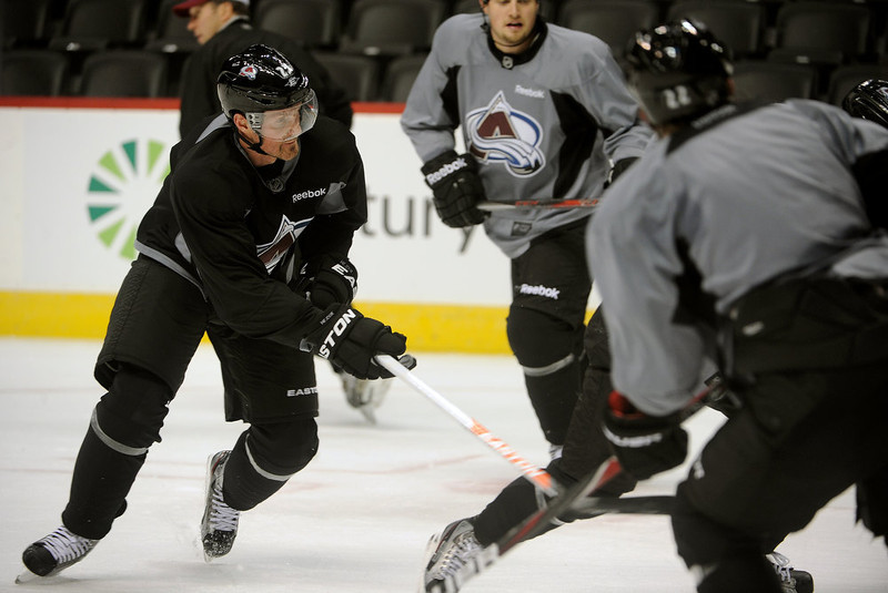 . Colorado Avalanche right wing Milan Hejduk, left, tries to get a hold of the puck during practice January  17th, 2013.The Colorado Avalanche hit the ice for the first time this season at the Pepsi Center.  After long months of contract negotiations the season has finally started. Helen H. Richardson, The Denver Post