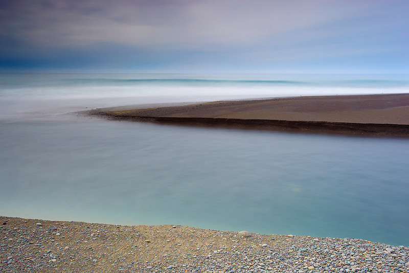 Image #1 of 2. The Mattole river flows from high mountains to the deserted Lost coast of Humboldt county. There are no towns on this stretch of coastline. It is desolate and beautiful. In this set of two images, it was a foggy day so I decided to make an abstract representation of the river mouth rather than my normal style of highly detailed seascapes.