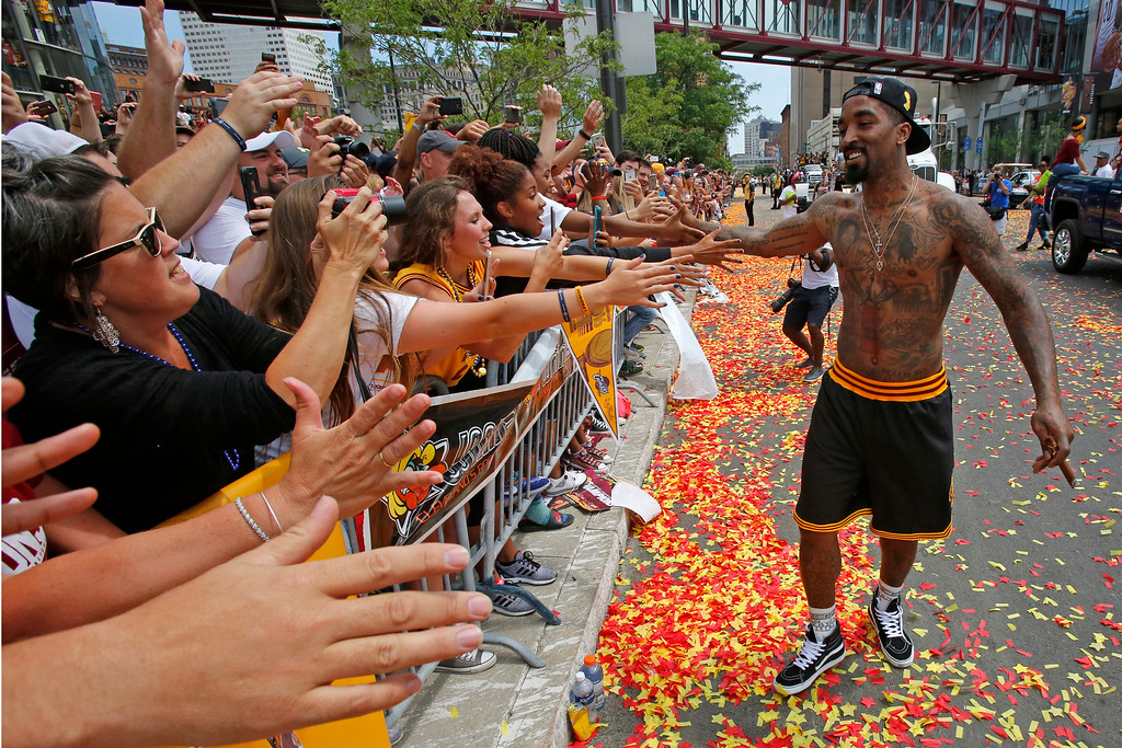 . Cleveland Cavaliers\' J.R. Smith, right, greets fans before the start of a parade celebrating the basketball team\'s NBA championship in downtown Cleveland, Wednesday, June 22, 2016. (AP Photo/Gene J. Puskar)