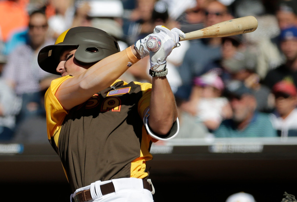 . U.S. Team\'s Hunter Renfroe, of the San Diego Padres, hits against the World Team during the first inning of the All-Star Futures baseball game, Sunday, July 10, 2016, in San Diego. (AP Photo/Matt York)