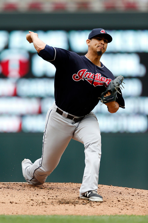 . Cleveland Indians pitcher Carlos Carrasco throws against the Minnesota Twins in the first inning of game one of a double header baseball game Thursday, Aug. 17, 2017, in Minneapolis. (AP Photo/Jim Mone)