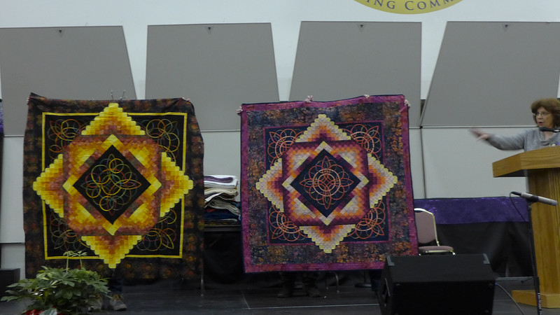 Char Ezell told us that she and her husband, Fred Diehl, make quilts.  He didn't work on this project.  The quilt was difficult to make and she borrowed the one on the left from a friend to assist her with finishing her own version.