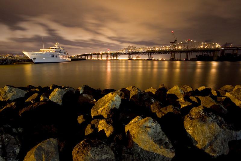 Blue Moon yacht, Bay Bridge, and rocks from Treasure Island