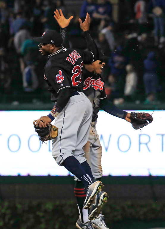 . Cleveland Indians\' Rajai Davis, left, and Francisco Lindor celebrate the team\'s 1-0 win over the Chicago Cubs in a baseball game Wednesday, May 23, 2018, in Chicago. (AP Photo/Jim Young)