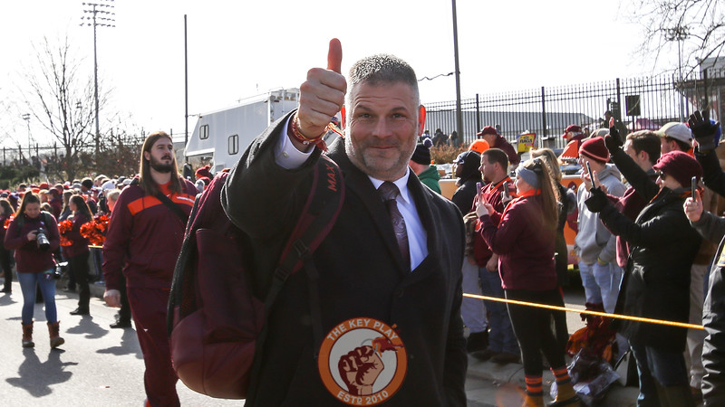 Hokies head coach Justin Fuente flashes a thumbs-up to the fans on the walk. (Mark Umansky/TheKeyPlay.com)