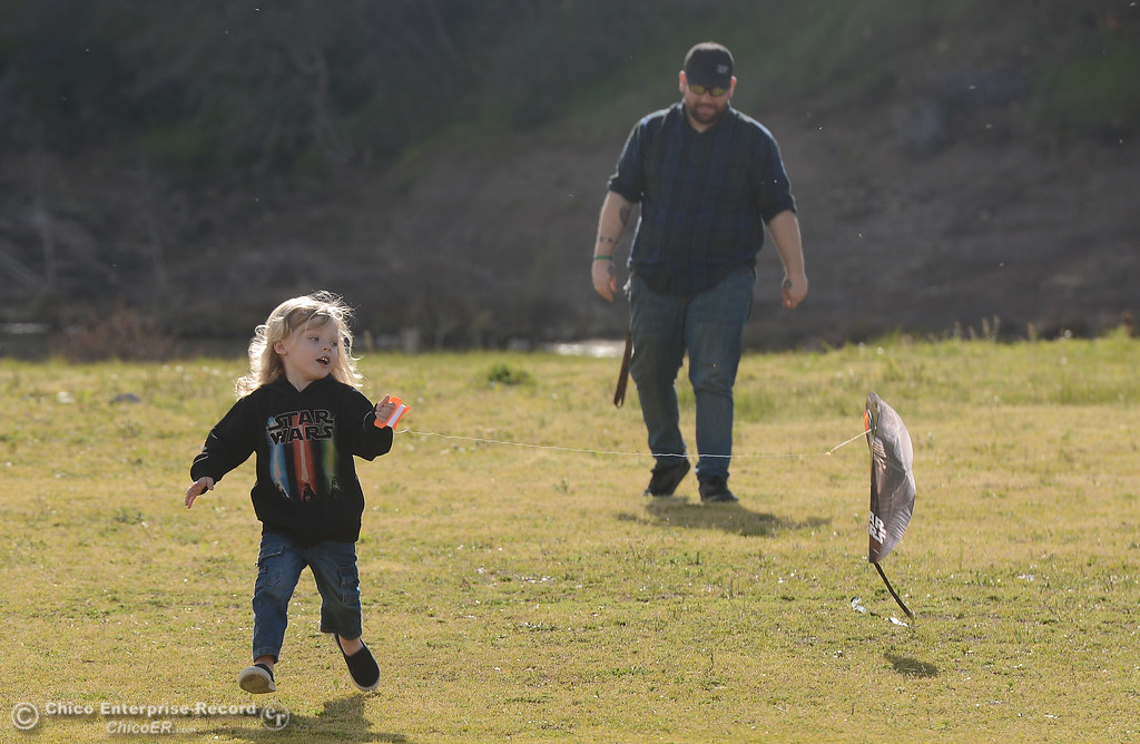 . Liam Provance tries to fly a kite for the first time as his dad, Travis Provance, watches from behind, Thursday, March 8, 2018, in Oroville, California. (Carin Dorghalli -- Enterprise-Record)