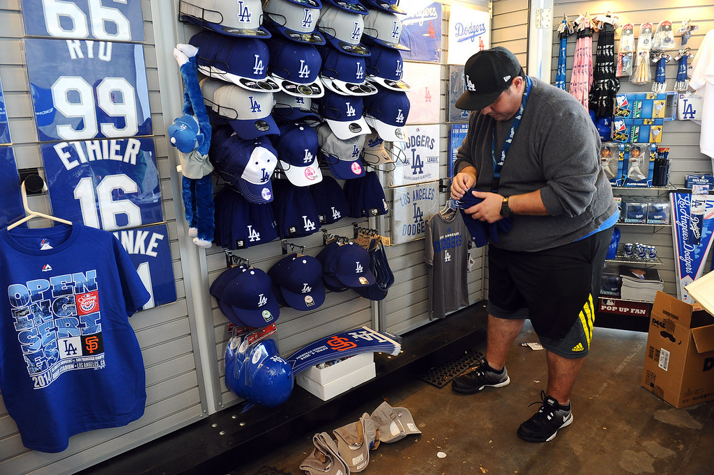 . Sal Battaglia prepares his stall for the Opening Weekend series with the Giants at  Dodger Stadium Thursday April 3, 2014.(Andy Holzman/Los Angeles Daily News)