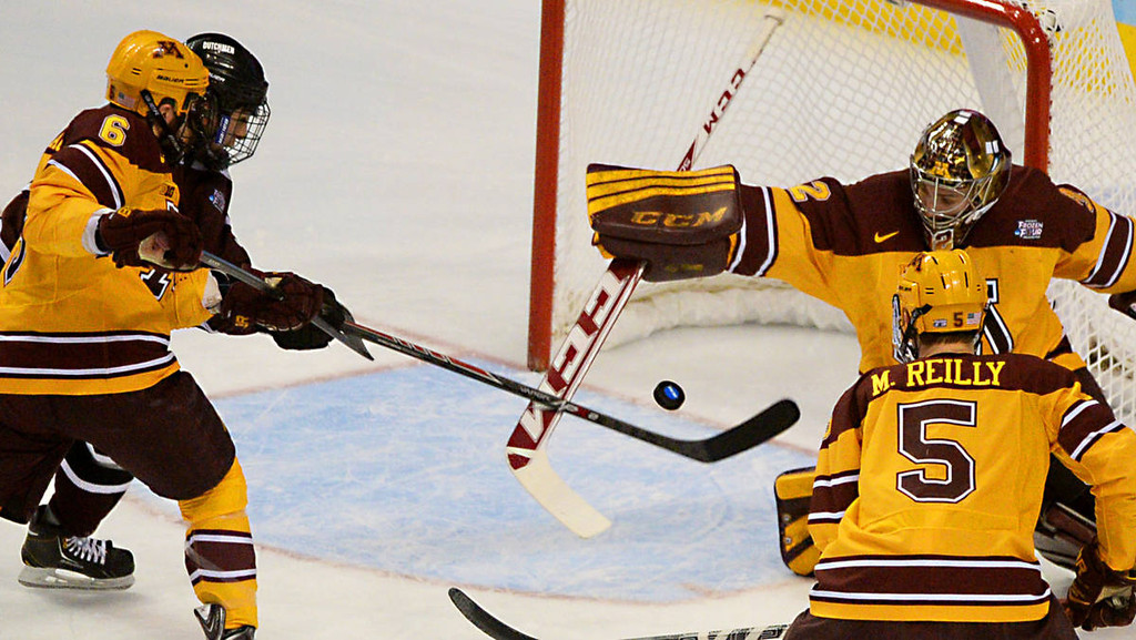 . Minnesota sophomore goalie Adam Wilcox, right, and Union College junior forward Daniel Ciampini cross sticks in the first period of the NCAA Frozen Four Championship Game at the Wells Fargo Center in Philadelphia, Saturday, April 12, 2014.  (Pioneer Press: John Autey)