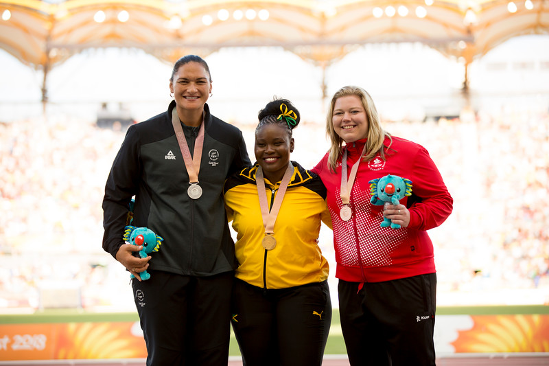 Dame Valerie Adams is presented with her Silver Medal for the Shot Put with Danniel Thomas-Dood (gold) and Brittany Crew (silver) at the 2018 Commonwealth Games. Gold Coast, Australia. Copyright photo: Alisha Lovrich / www.photosport.nz