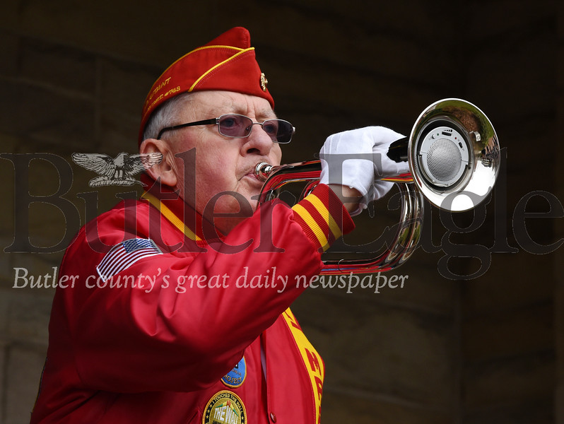 Harold Aughton/Butler Eagle: Jerry Puff, 78, of the Marine Corps League 743, plays taps during the Butler Veterans Day parade.
