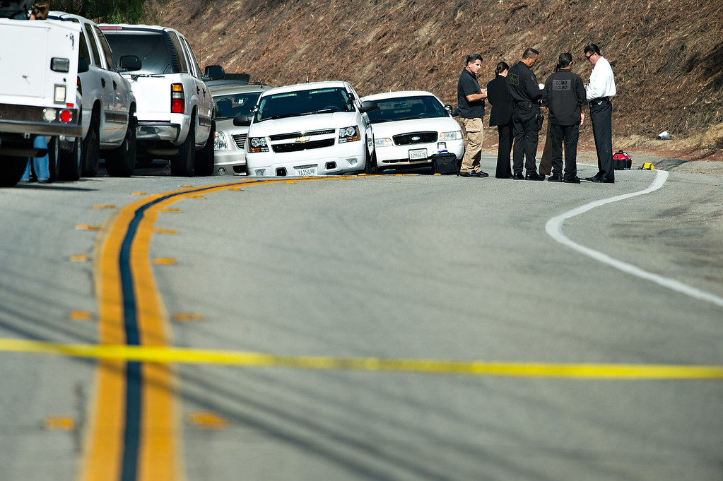 . Los Angeles County sheriff�s officials investigate the scene where an unidentified burned body was found along the side of Covina Hills Road west of Via Verde Street in the unincorporated area of Covina on Tuesday morning, August 20, 2013. (SGVN/Staff photo by Watchara Phomicinda)