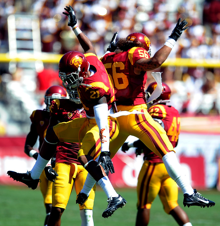 . Southern California safety Su\'a Cravens (21) reacts along with linebacker Anthony Sarao (56) after stopping Boston College on fourth down during the second half of an NCAA college football game in the Los Angeles Memorial Coliseum in Los Angeles, on Saturday, Sept. 14, 2013. Southern California won 35-7. 