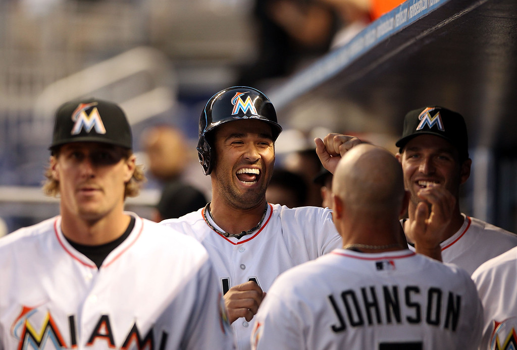 . Garrett Jones #46 of the Miami Marlins celebrates scoring a run with teammates against the Colorado Rockies during the third inning at the Marlins Park on April 1, 2014 in Miami, Florida.  (Photo by Marc Serota/Getty Images)