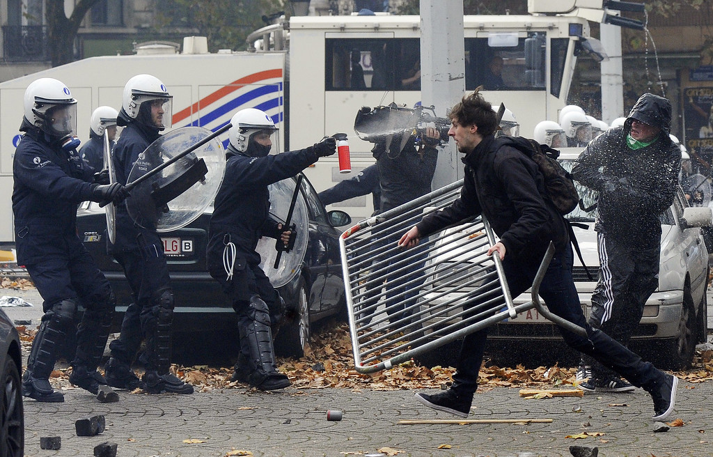 . Demonstrators clash with riot police on November 6, 2014 in Brussels in the first mass protest against the new centre-right government\'s austerity policies.   AFP PHOTO / JOHN  THYS/AFP/Getty Images