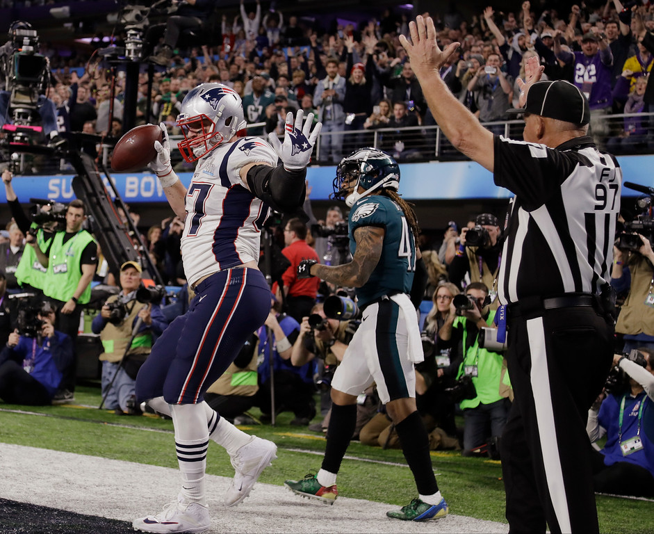 . New England Patriots tight end Rob Gronkowski (87) dances as he celebrates a touchdown reception, during the second half of the NFL Super Bowl 52 football game against the Philadelphia Eagles, Sunday, Feb. 4, 2018, in Minneapolis. (AP Photo/Chris O\'Meara)