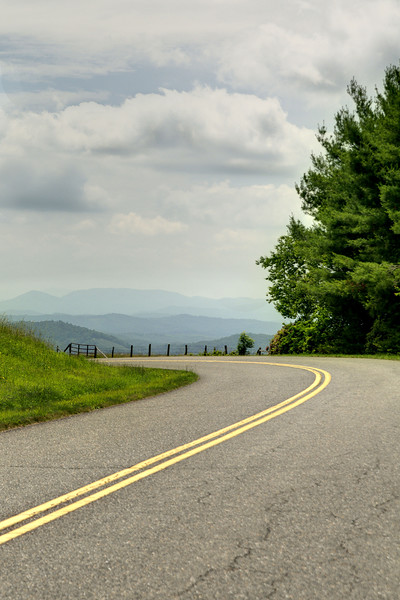 The winding road with beautiful views of distant mountains near Milepost 268 on the Blue Ridge Parkway in North Carolina on Friday, June 13, 2014. Copyright 2014 Jason Barnette