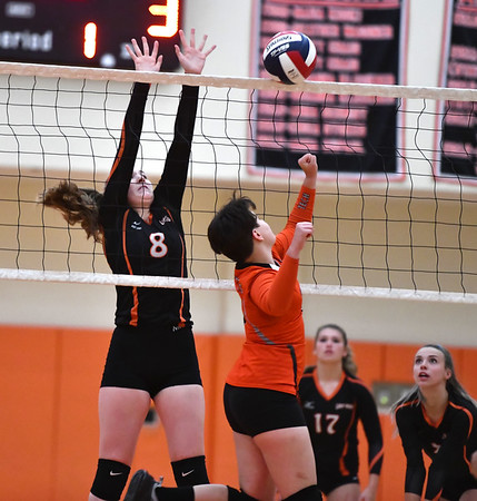 10/18/2019 Mike Orazzi | StaffrTerryville's Tiffany Pires (8) and Goodwin Tech's Tabetha Trammell (6) during Friday night's girls volleyball match in Terryville. r