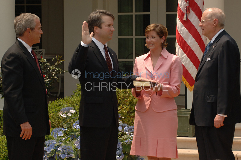 Brett Kavanaugh is sworn in by  Supreme Court Associate Justice  Anthony Kennedy  for the position of  Circuit Court Judge for the U.S. Court of Appeals for the District of Columbia  Circuit. Brett's wife Ashley holds the bible as President Bush looks on.