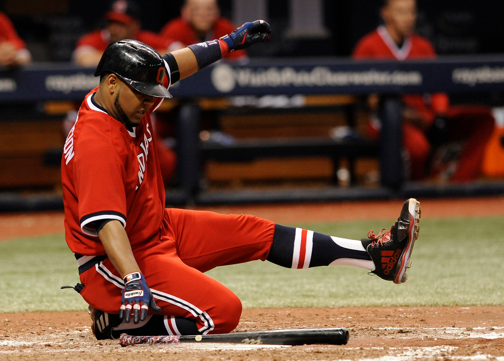 . Cleveland Indians\' Edwin Encarnacion falls to his knee on a swing during the sixth inning of the team\'s baseball game against the Tampa Bay Rays Saturday, Aug. 12, 2017, in St. Petersburg, Fla. (AP Photo/Steve Nesius)
