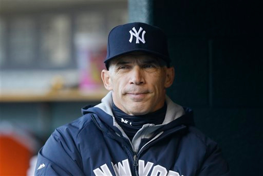 . New York Yankees manager Joe Girardi is seen in the dugout during the first inning of a baseball game against the Detroit Tigers, Tuesday, April 21, 2015, in Detroit. (AP Photo/Carlos Osorio)