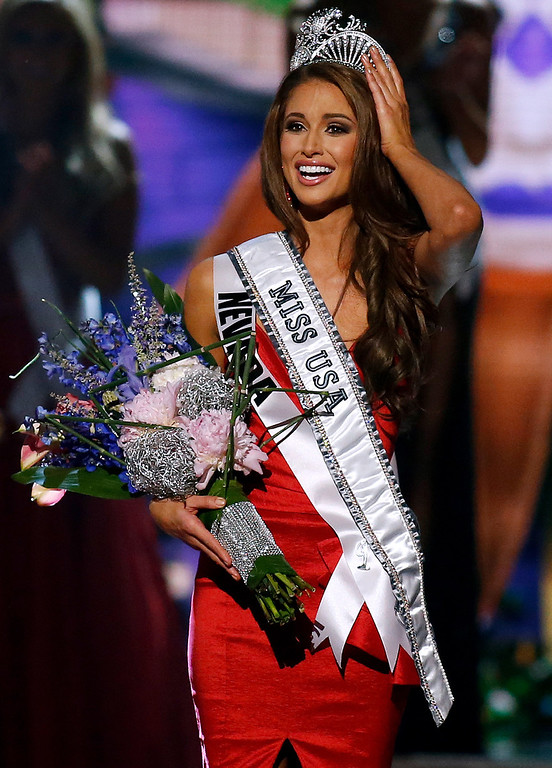 . Miss Nevada USA Nia Sanchez is crowned Miss USA during the Miss USA 2014 pageant in Baton Rouge, La., Sunday, June 8, 2014. (AP Photo/Jonathan Bachman)