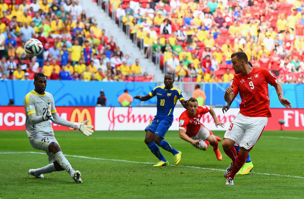 . Haris Seferovic of Switzerland scores his team\'s second goal past Alexander Dominguez of Ecuador during the 2014 FIFA World Cup Brazil Group E match between Switzerland and Ecuador at Estadio Nacional on June 15, 2014 in Brasilia, Brazil.  (Photo by Stu Forster/Getty Images)