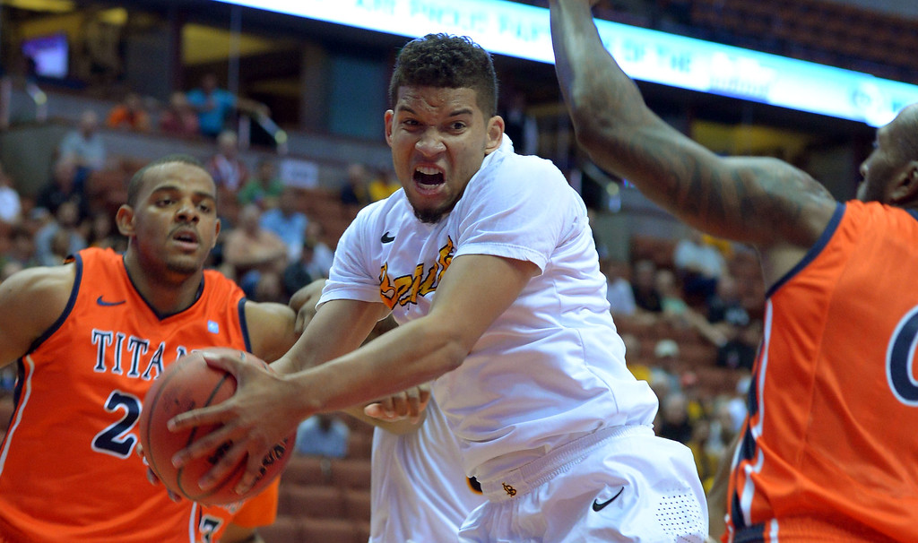 . LBSU\'s Tyler Lamb pulls down a rebound at the Honda Center in Anaheim, CA on Thursday, March 13, 2014. Long Beach State vs CSU Fullerton in the Big West men\'s basketball tournament. 1st half. LBSU won 66-56.  Photo by Scott Varley, Daily Breeze)