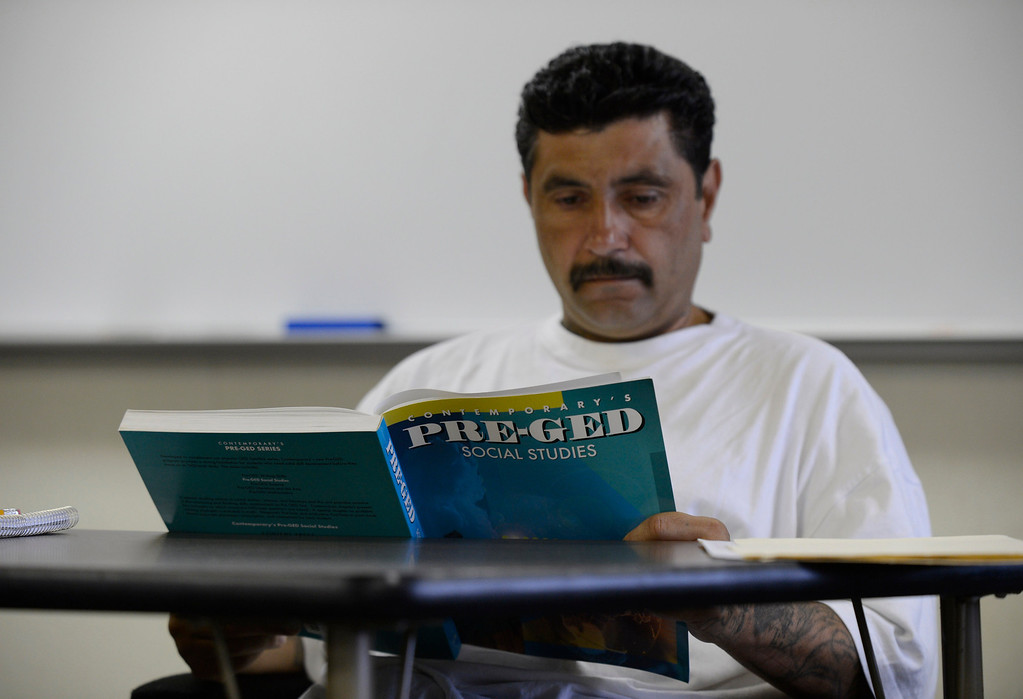 . Robert Nevotti, of Antioch, studies from a Pre-GED social studies book before taking a practice test for the GED while attending a six week GED summer class at the Pittsburg Adult Education Center in Pittsburg, Calif. on Monday, June 24, 2013. The GED, is undergoing an overhaul in January, switching to computers, condensing from five tests to four, requiring more analysis and a deeper understanding of math. At the end of December, many students who have begun taking the five tests currently necessary to obtain the certificate are ramping up their efforts, because they\'ll have to start over if they\'re not done by Dec. 31. (Jose Carlos Fajardo/Staff)